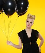 Lovely lady with black balloons — Stock Photo