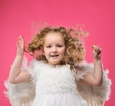 Beautiful little angel girl isolated on pink background — Stock Photo