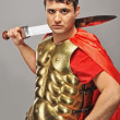 Handsome roman legionary soldier — Stock Photo