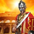 Roman legionary soldier in front of coliseum — Stock Photo #5812201
