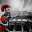 图库照片: Roman legionary soldier in front of coliseum