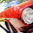 Stock Photo: Fragment of red retro car