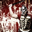 Legionary soldier over abstract bloody wall — Stock Photo #5812779
