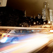 Foto de Stock  : Fast moving cars at night