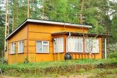 Old wooden house in the forest — Stock Photo