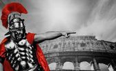 Angry legionary soldier in front of coliseum — Stock Photo