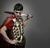 Handsome roman legionary soldier — Stock Photo
