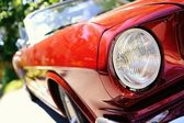 Fragment of red retro car — Stock Photo