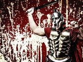 Legionary soldier over abstract bloody wall — Stock Photo