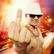 Man showing middle finger in front of night city — Stok fotoğraf