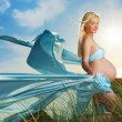 Beautiful pregnant woman outdoors — Stok fotoğraf