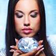 Beautiful woman with a diamond — Stock Photo