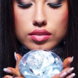 Close-up portrait of a beautiful woman with a diamond — Stock Photo #5867621
