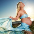 Beautiful pregnant woman outdoors - Stock Photo