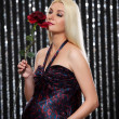 Stock Photo: Attractive pregnant woman with red rose