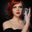 Beautiful singer with a microphone — Stock Photo