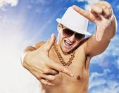 Handsome man in white had in front of blue sky — Stock Photo