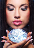 Close-up portrait of a beautiful woman with a diamond — Stock Photo