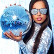 Beautiful brunette with disco ball — Stock Photo