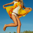 Happy little girl jumping — Stock Photo