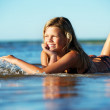 Happy girl lying in the water — Stock Photo #5893253