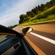 Fast moving car — Stock Photo