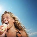 Happy girl eating icecream outdoors — Stock Photo
