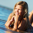 Foto Stock: Happy girl relaxing in the water