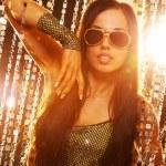Stylish brunette in the nightclub — Stock Photo