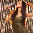 Beautiful brunette singer performing on a stage — ストック写真
