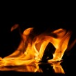 Fire flames reflected in water — Stock Photo