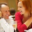 Happy couple in a restaurant — Stock Photo