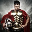 Roman legionary soldier over stormy sky — Stock Photo
