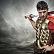 Stock Photo: Legionary soldier over stormy sky