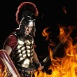 Angry legionary soldier in the fire - Stok fotoğraf
