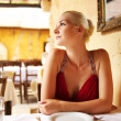 Beautiful woman in a restaurant — Stock Photo
