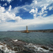 Beautiful lighthouse over blue cloudy sky — Stock Photo