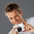 Young man with a photocamera — Stock Photo #5893770