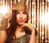 Attractive brunette woman in the night club — Stock Photo