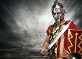 Legionary soldier over stormy sky — Stockfoto