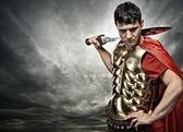 Legionary soldier over stormy sky — Stock Photo