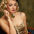 Lovely woman with a phone. Retro portrait — Stock Photo