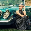 Beautiful lady sitting near retro convertible — Stock Photo