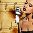 Beautiful singer against abstract background — Stock Photo #6228485