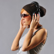 Foto Stock: Stylish young girl with headphones