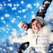 Happy smiling couple on a winter background — Stock Photo #6228637