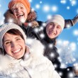 Happy friends on a winter background — Stock Photo
