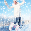 Happy girl jumping in the snow - Foto de Stock