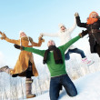 Happy friends jumping in the snow — Stock Photo
