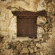 Window in the stone wall — Stock Photo
